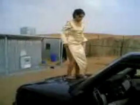Arab Girl Dancing on top of the Car in the Camp