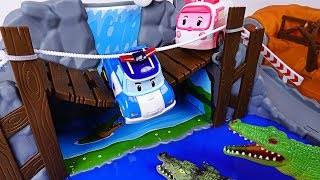 Video They are being chased by dinosaurs, crocodiles! Rescue the dangerous Robocar Poli. - DuDuPopTOY MP3, 3GP, MP4, WEBM, AVI, FLV Maret 2018