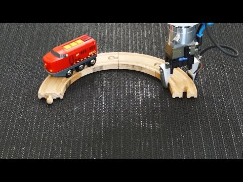 Robotic Arm Continuously Removes And Adds Circular Track Sections For Toy
