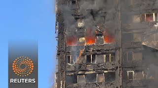 At least 17 dead as fire engulfs London tower block