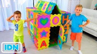 Vlad dan Nikita membangun Playhouse berwarna