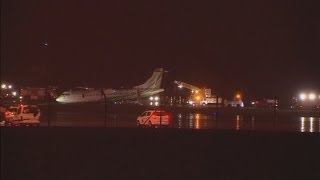 Spain: heavy flooding causes plane to slide from runway