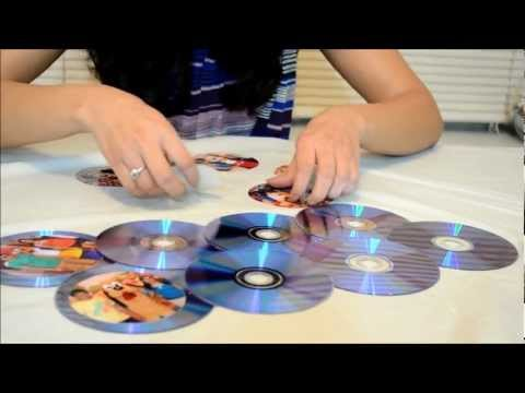 making picture frames - This video describes how to make use of waste CDs which are discarded by people with the help of unused photos. This is simple and easy to make. You just nee...