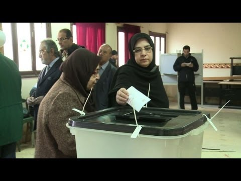 Egyptians vote on divisive new constitution