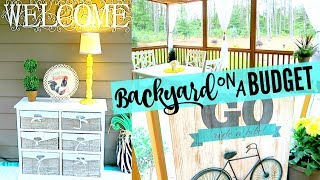 Backyard Home Tour! Decorating on a budget is what we will be talking about in this video! Y'all know me, Walmart, Thrift Stores, Hobby Lobby, Yard Sales and The Christmas Tree Shop is how I decorated my back porch on a tight budget! I hope you all enjoy seeing this outside house tour! Link to my Back-to-School Giveaway (open until 8-5-17): https://gleam.io/RLG2O/lovemegs-backtoschool-giveawayHere is the equipment that I use in making my videos:Canon G7X: http://amzn.to/2qycaSkApple MacBook Pro: http://amzn.to/2ppPlm9Final Cut Pro Software: http://amzn.to/2pzyhsiSunPak Tripod: http://amzn.to/2r7VmCUThese are some products that I get asked about a lot:ALL my cleaning products: https://www.grove.co/referrer/998436/My Dyson Vaccuum: http://amzn.to/2r71qi6Julie's Quilt: http://amzn.to/2r6CkA0CHECK ME OUT ON SOCIAL MEDIA..........Instagram: https://instagram.com/lovemeg09/Twitter: https://twitter.com/lovemegyoutubePinterest: https://www.pinterest.com/meglovesjustin/Mailing Address: PO Box 12, Olivia NC, 28368HERE ARE A FEW OF MY FAVORITE VIDEOS.........SHABBY CHIC FARMHOUSE HOME TOURhttps://www.youtube.com/watch?v=n8xe_W_vUTMWHAT ITS LIKE TO BE MARRIED AT 18https://www.youtube.com/watch?v=f8hhULsCptE10 NETFLIX TV SHOWS TO BINGE WATCHhttps://www.youtube.com/watch?v=ULBmR0c5Gn4DAY IN THE LIFE OF A FIREFIGHTERS WIFE  24 HOUR SHIFThttps://www.youtube.com/watch?v=Tni8T11tMvkMY WEIGHT LOSS JOURNEYhttps://www.youtube.com/watch?v=hGULnv1nark