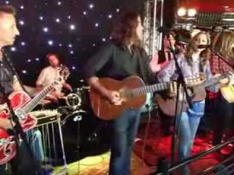 Tony Suraci and Holly Palmer perform