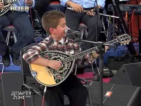 greek boy - greek boy with bouzouki.