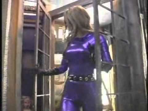 dyna flix.com - Sexy catsuit clad crime-fighting cutie DareDoll Minx sneaks into the Peepers hideout via a rope ladder (from Episode 11a), and proceeds to take out the dasta...