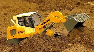 Fantastic RC model dozer Liebherr 634 at work on the rc construction site. Amazing model machine in sacale 1/10. Enjoy watching...Event: Model Construction Fair in Wels Austria April 2017More videos from this event you can see my playlist:https://www.youtube.com/playlist?list=PLeQrXy3lR8j_7-Z1A-_Oo1dXIhpBfwR2yCredit: RC SPOTTER