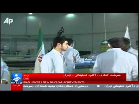 Iran reactor - Iran says it has begun loading domestically made nuclear fuel rods into its Tehran research reactor. The official IRNA news agency said Pres. Mahmoud Ahmadin...