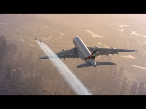 Jetman Flies Next To Airbus Jumbo Jet