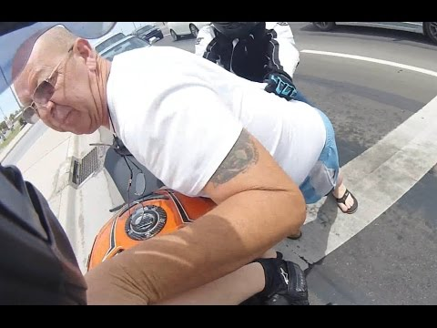 Road Rage Against Motoryclist Turns Physical