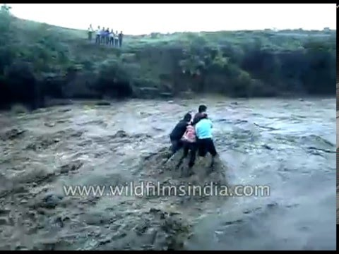 Dam flood gates open without notice - Indians fall off waterfall and drown