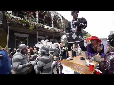 Orleans Carnival Royal - It was early afternoon on Mardi Gras Day on Royal Street in the French Quarter of New Orleans, where the marching groups parade. Many groups have floats and ...