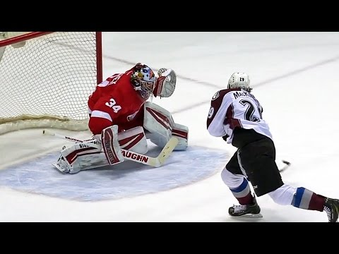 beats - Colorado Avalanche forward Nathan MacKinnon uses a series of lethal moves to score a shootout goal on Detroit Red Wings goalie Petr Mrazek.