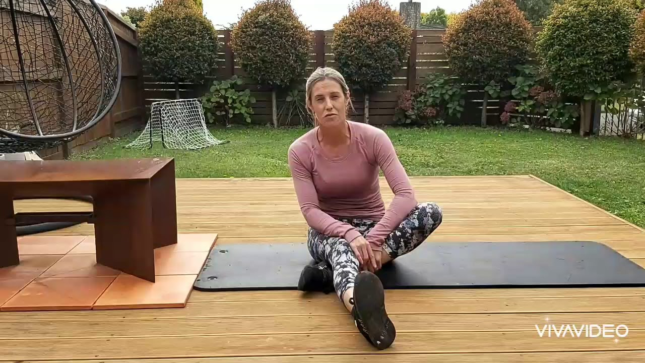 YouTube placeholder image shows still from video of woman doing yoga in her garden.
