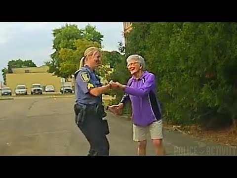 Police Sergeant Joins Woman Dancing Alone in Street