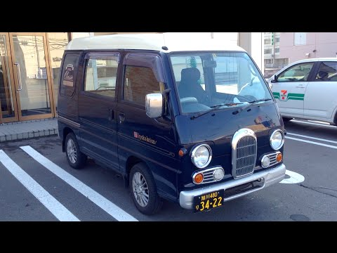 Japan - This is a 5th Generation Subaru Sambar which is a 660cc 4WD mini van from Japan. And this one has fish net curtains… Yellow on black number number plate means this a commercial Kei car....