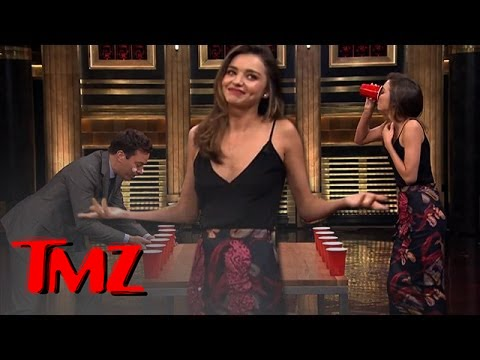 flip - Jimmy Fallon played against the bombshell Miranda Kerr at flip cup, awesome! Except the cups weren't full beers, what gives?!