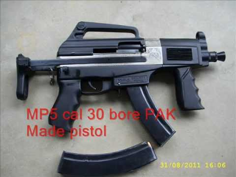 30 bore - THIS IS MP5 MODEL PISTOL CAL 30 BORE PAK MADE.25 BULLETS IN ON CARTAGE.8-12 BULLETS AUTOMATICALLY FIRE IN SECONDS.VERY NICE GUN FOR SECURITY PURPOSE.