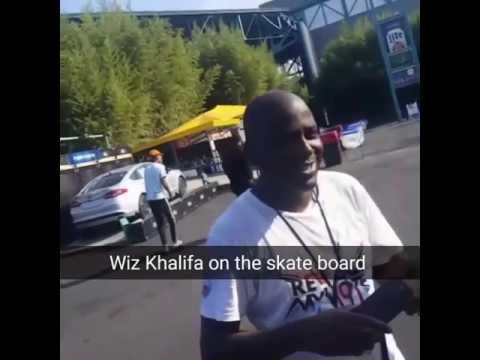 Wiz Khalifa wizzes by on a skateboard