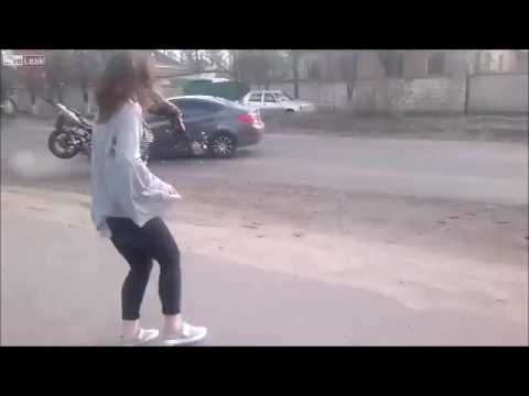 MOTORCYCLE CRASHES HEAD ON WITH CAR IN BACKGROUND OF GIRLS DANCE VIDEO
