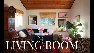 """Here is my Living Room.  It's not totally traditional but I'm a big fan of creating a space that works for Y O U !  The best décor advice I ever received was, """"if you paint something in your home or you put something in your home and it doesn't work for you, change it immediately.""""  Anyway, here's a little before & after action for you.  Let me know your thoughts!  I linked to as much as possible below.  F O L L O W   M E ! ! ! SUBSCRIBE for more! -  https://www.youtube.com/HeyMaryElizabethINSTAGRAM -                 https://instagram.com/heymaryelizabeth/FACEBOOK -         https://facebook.com/maryelizabethTWITTER -                       https://twitter.com/maryelizabethPINTEREST -                    https://www.pinterest.com/HeyMaryPins/SNAPCHAT -                   TotallyRadicalHOW TO SELL ON CRAIGSLIST:  I N   M Y   H O M E :1. APT 2B Sectional in Sapphire – https://www.apt2b.com/products/scott-2pc-l-sectional-from-kyle-schuneman-choice-of-fabrics2. E Sale Rugs Vintage Rug – http://esalerugs.com/persian-rugs3. CB2 Coffee Table turned Vintage Hybrid Dining Table – http://rstyle.me/n/cqgzvcbqpf74. CB2 Acrylic Waterfall Console  – http://rstyle.me/n/cqgzusbqpf75. Bamboo Blinds  – http://rstyle.me/n/bdv2j6bqpf76. Shibori Sofa Pillow, Vintage Fabric – http://www.agouraantiquemart.com/7. Faux Mongolian Sofa Pillow – HomeGoods8. Misc Sofa Pillows – HomeGoods9. Black & White Art Work -- https://www.canvaspop.com/10.  Pink Chair  – Vintage {Thrifted & Reupholstered in Cotton/Linen Blend}11.  Moroccan Pouf  -- http://rstyle.me/n/cqgz6ibqpf712.  Mirrored Side Table --  HomeGoods 13.  Leopard Chairs – Vintage via Ebay & Reupholstered in """"Braemore Jamil Natural"""" : https://www.fabricmill.com/braemore-jamil-natural.html14.  Acrylic & Glass Table – Thrifted15.  Antique Trunk – Craigslist 16. Burlwood Secretary – hehomeconsignmentcenter.com17. Grey Linen Sofa, Custom – Sofa U Love18.  Tan Rug, Vintage – http://www.agouraantiquemart.com/19.  Glass Mid Century Coffee Table – Craig"""