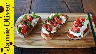 Gennaro gives us his take on this classic, simple and delicious Italian dish; Tomato & Ricotta Bruschetta. A beautiful mix of two of Italy's most famous cheeses, Mozzarella and Ricotta, make the base of this Bruschetta and the dish is topped of with roasted cherry tomatoes and fresh basil leaves. Fantastico!  To book a table or to find out where your nearest Jamie's Italian is, head over to http://jamieol.com/Jamies_Italian for more information.Links from the video:Gennaro finds an incredible Italian Cheese Shop  http://jamieol.com/cheeseshopThe Porkie Pizza  http://jamieol.com/porkiepizzaFresh Prawn Linguine  http://jamieol.com/prawnlinguine5 Things... Tomatoes  http://jamieol.com/Tomatoes5WaysFor more information on any Jamie Oliver products featured on the channel click here: http://www.jamieoliver.com/shop/homeware/For more nutrition info, click here: http://jamieol.com/NutritionSubscribe to Food Tube  http://jamieol.com/FoodTubeSubscribe to Drinks Tube  http://jamieol.com/DrinksTubeSubscribe to Family Food Tube  http://jamieol.com/FamilyFoodTubeTwitter  http://jamieol.com/FTTwitterInstagram http://jamieol.com/FTInstagramFacebook  http://jamieol.com/FTFacebookMore great recipes  http://www.jamieoliver.comJamie's Recipes App  http://jamieol.com/JamieApp#FOODTUBEx