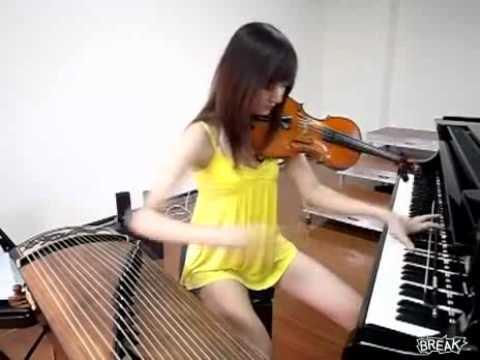 Cô gái Đài Loan đánh 3 loại nhạc cụ trong một bản nhạc