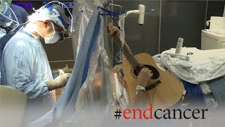 Brain tumor patient plays guitar during awake craniotomy surgery
