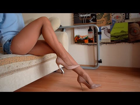 Pretty Girl In Nylon Pantyhose Shows Her Feet On High Heels