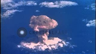 Link to order this clip: http://www.criticalpast.com/video/65675046790_nuclear-test_goes-off-high-in-sky_forming-a-white-fireball_cloud-of-the-blast-rises Hi...