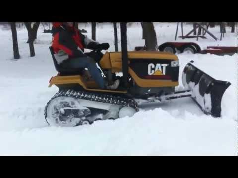 Mini Cat Challenger Tractor snow plowing
