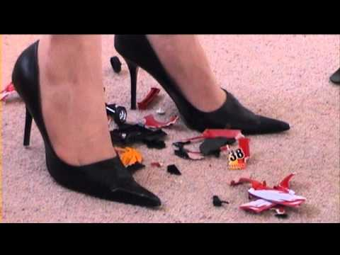 high heels crush - Another toy-crush video for the fans of the first one. Not as easy to crush as the car in the first clip. Had to break it into smaller pieces before vacuumin...