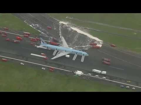 A Korean Air Lines plane preparing to take off from a Tokyo airport had to evacuate its passengers after smoke came out of its left engine.
