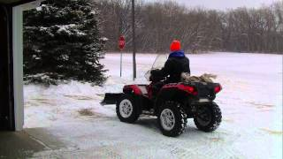3. PLOWING SNOW WITH THE 2010 POLARIS SPORTSMAN 850 XP.