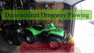 1. Driveway Snow Plowing: 2006 Kawasaki Prairie 700 ITP Tires Brute Force