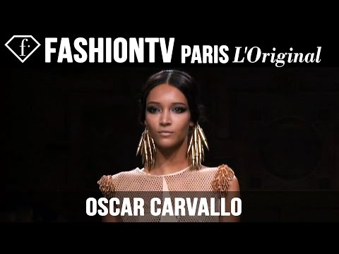 Fashion TV - http://www.FashionTV.com/videos PARIS - The Oscar Carvallo couture collection for fall/winter 2014-15 is shimmering and ethereal, and the runway show goes out with a 'bang' in the form...