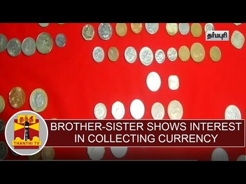 Brother-Sister-shows-interest-in-collecting-old-world-currency-notes-coins
