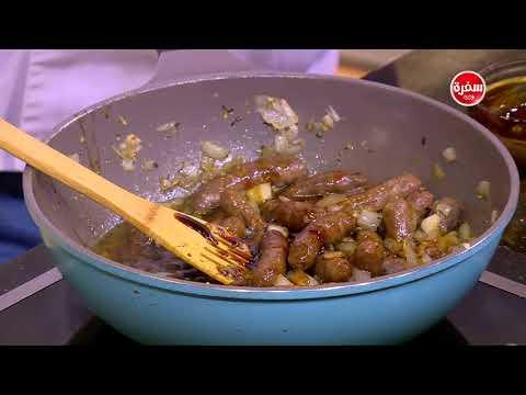 العرب اليوم - بالفيديو : طريقة إعداد صينية بطاطس بالسجق والثوم