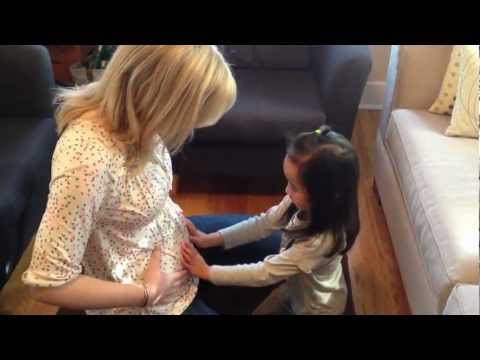 A little girl finds out she's going to be a big sister
