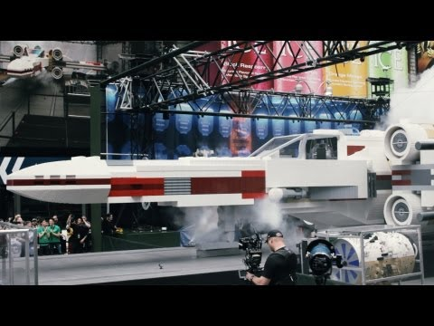 Square - LEGO unveiled a Star Wars X-Wing Starfighter construction set in Times Square. It is 11-feet tall, 43-feet long, weighs over 46000 pounds, and consists of o...