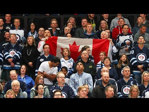 "crowd - The MTS Centre crowd takes a moment of silence and sings ""O Canada"" to pay their respects following the recent tragedies in Canada."