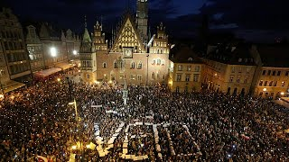 Tens of thousands of protesters gathered in Warsaw and cities across Poland for candle-lit vigils to protest against a bill to ...