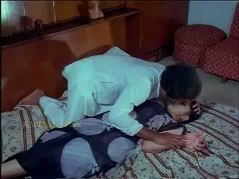 tamil actress - tamil old actress lakshmi hottest scene . she goes to bathtub and get current.there enters the hero to save her.she takes her to bed and scratches her legs a...