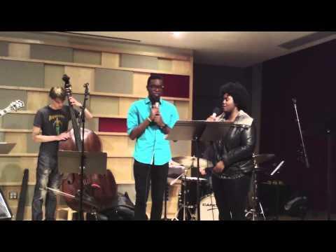 "Akenya and Michael Mayo singing, ""Twice,"" by Little Dragon."
