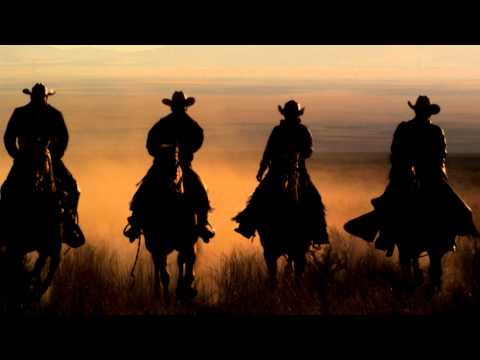 Cowboys Riding Horses At Sunset in West Desert.  Slow Motion HD & 4K Stock Video Footage