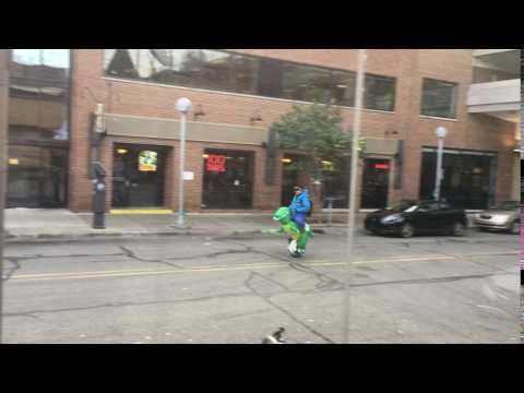 Guy Rides His Dinosaur to Work