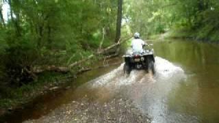 9. King Quad 750 Going Through A Stream