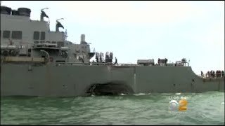 The commander of the U.S. Pacific Fleet said divers located some remains in a flooded compartment of the USS John McCain.